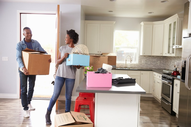 An image of a couple moving in