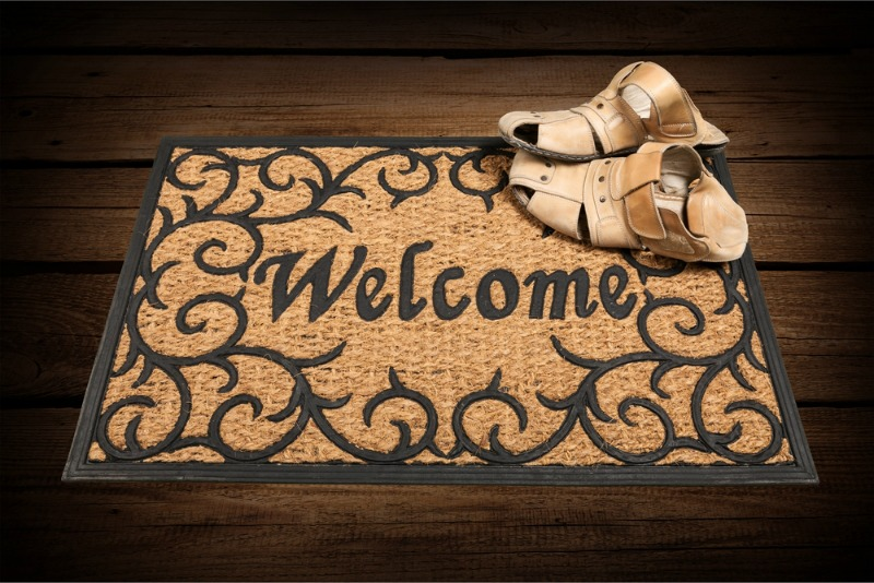 An image of a doormat with welcome written on it