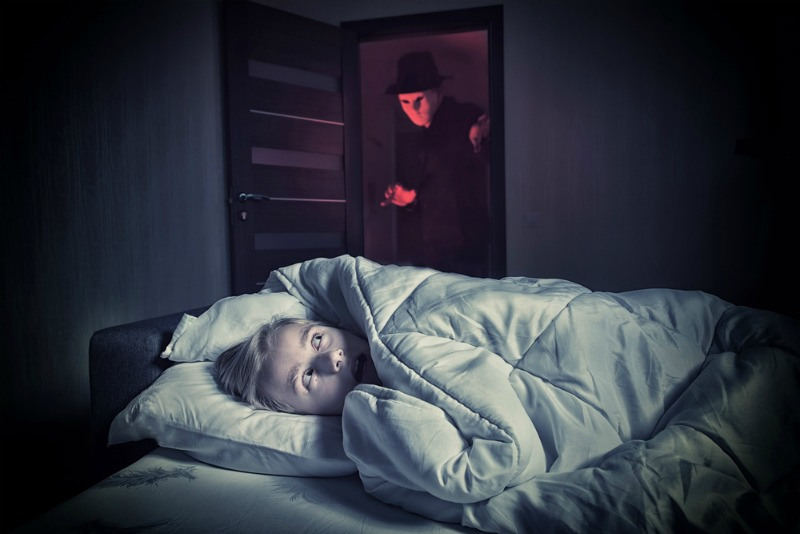 Sleep paralysis - Image of boy scared by man in door