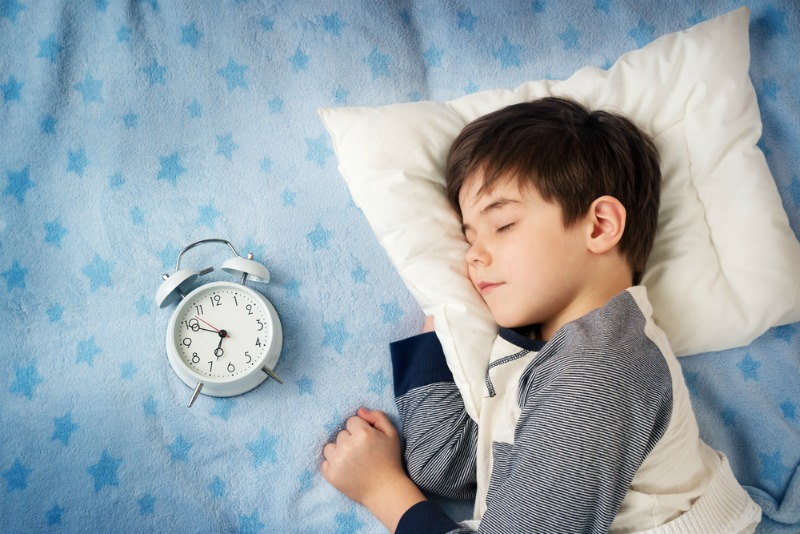 An image of a child sleeping with a pillow