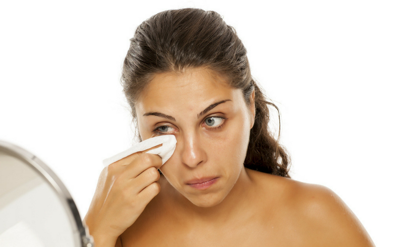 Image of woman cleaning sleepy dust from eyes