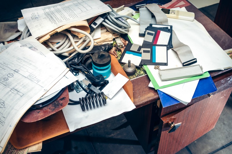 Image of a very cluttered desk