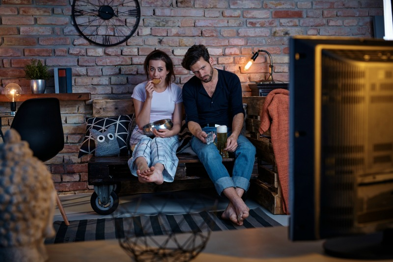 image of bored couple watching tv
