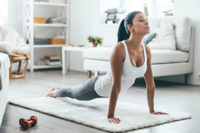 Image of woman exercising as ways to improve your sleep