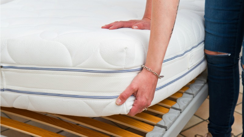 person buying a new bed and checking mattress