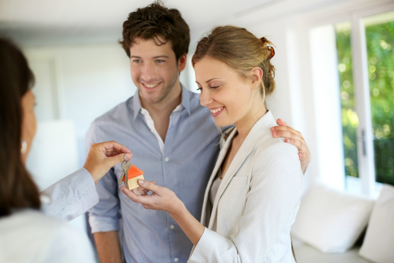 image of a couple getting keys to new home