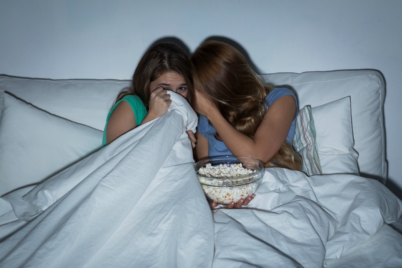 An image of girls watching a horror film