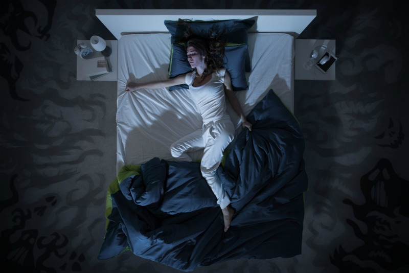 Image of woman too hot at night