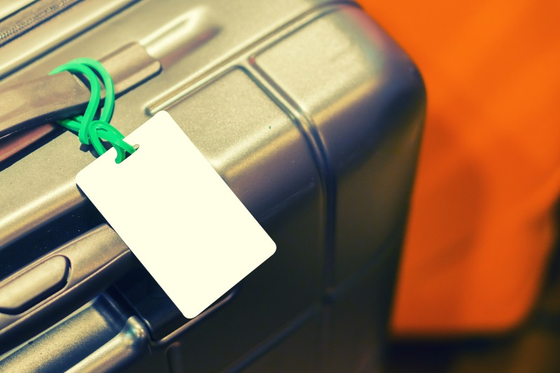 An image of luggage with a luggage tag