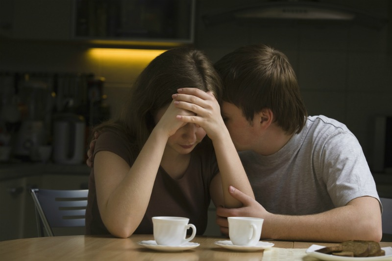 Image of man consoling partner