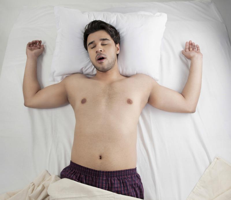 Image of man sleeping on back