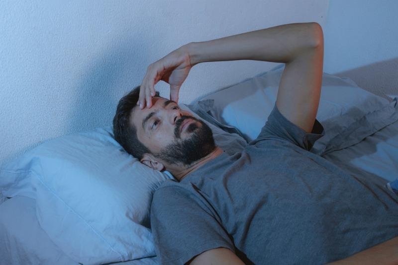 image of man unable to sleep