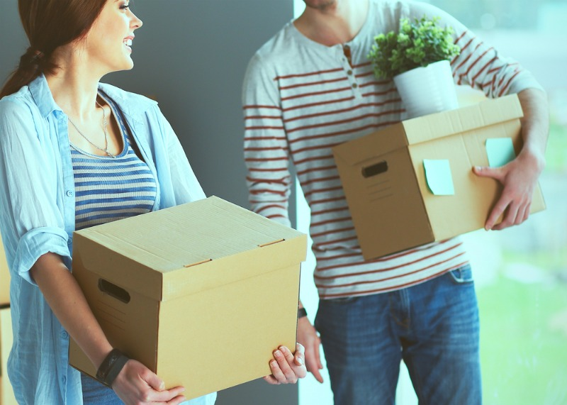 Sleep in your new home - an image of couple moving boxes