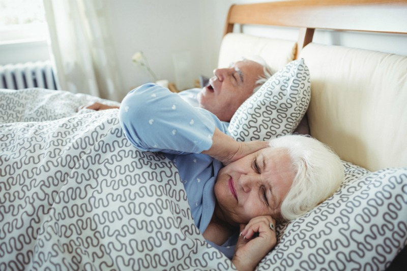 Image of older couple in bed