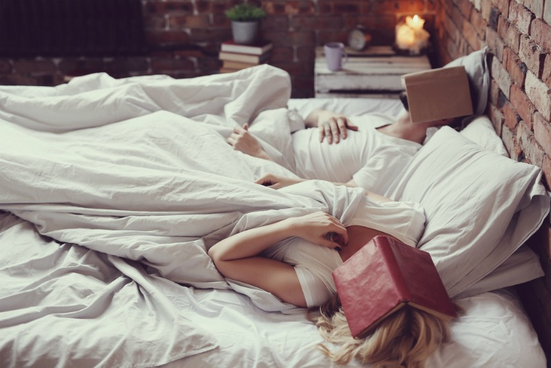 Image of a tired couple in bed