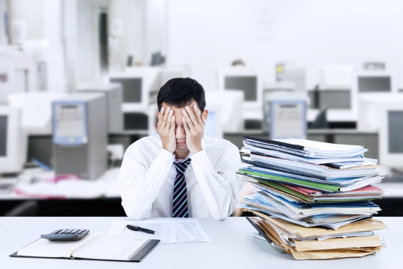 image of overworked man