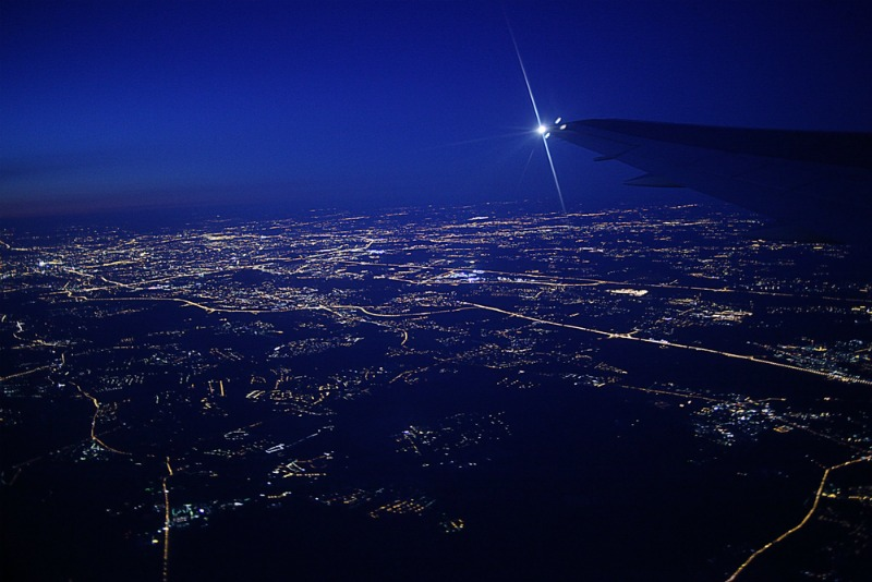 Image of plane flying at night