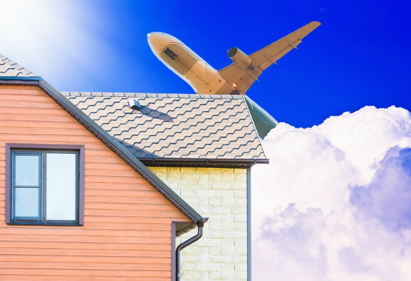 image of plane over a house