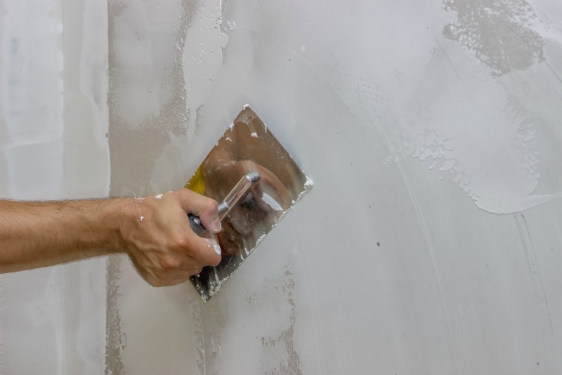 image of someone plastering