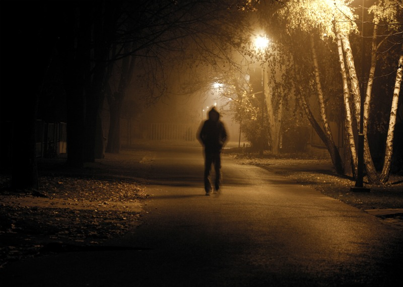 image of a scary man walking alone