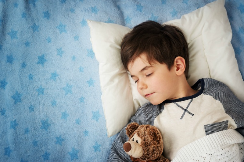 An image of a sleeping child at bedtime