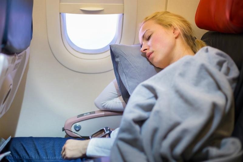 Image of woman sleeping on a plane