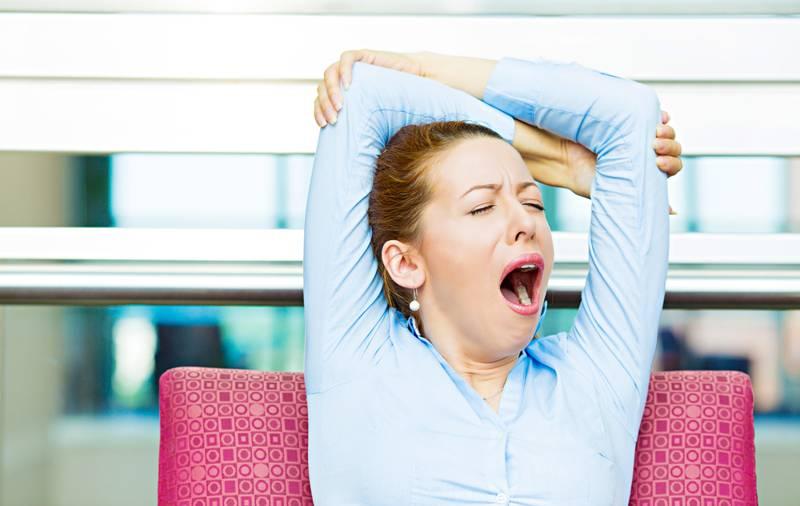 Woman yawning at work