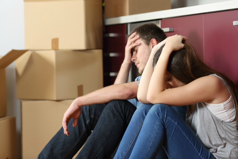 image of stressed couple moving home