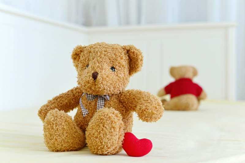 image of toy bears on bed