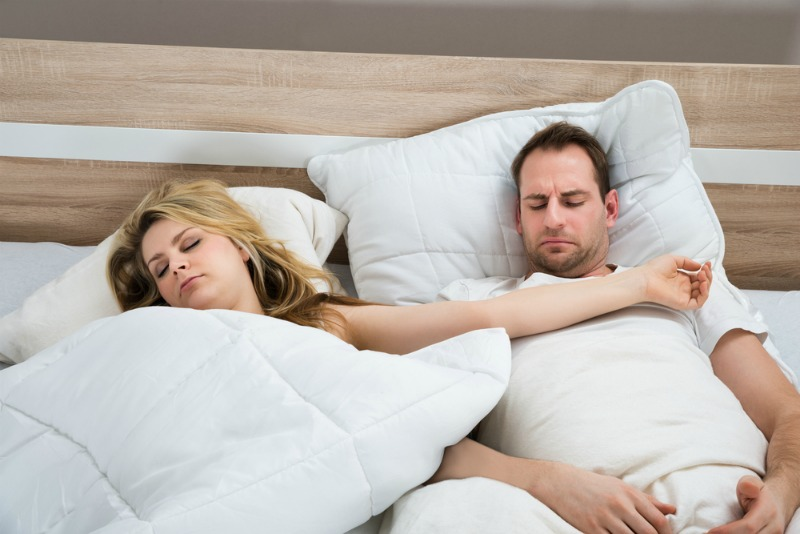 image of couple uncomfortable in bed