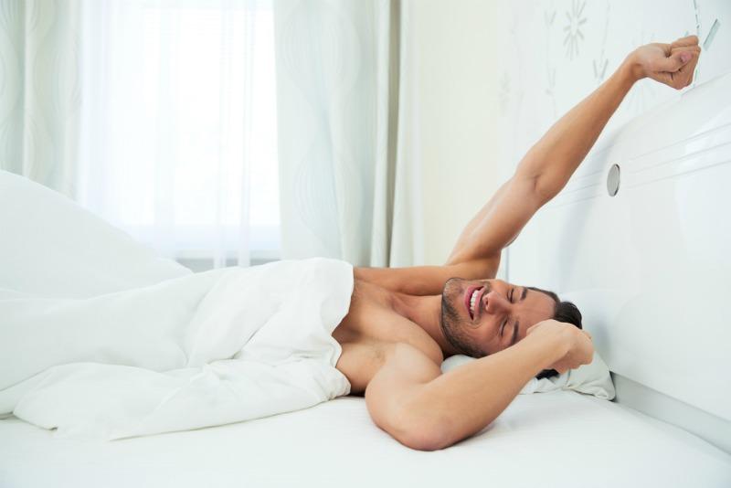 Image of man waking up naked
