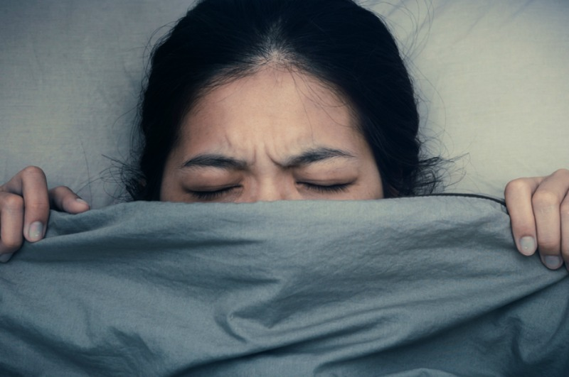 Image of frustrated woman in bed