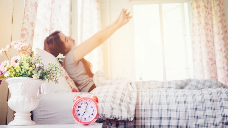 women waking up after clocks go forward