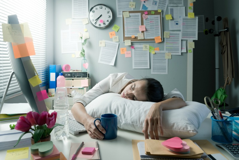 image of a woman asleep at work