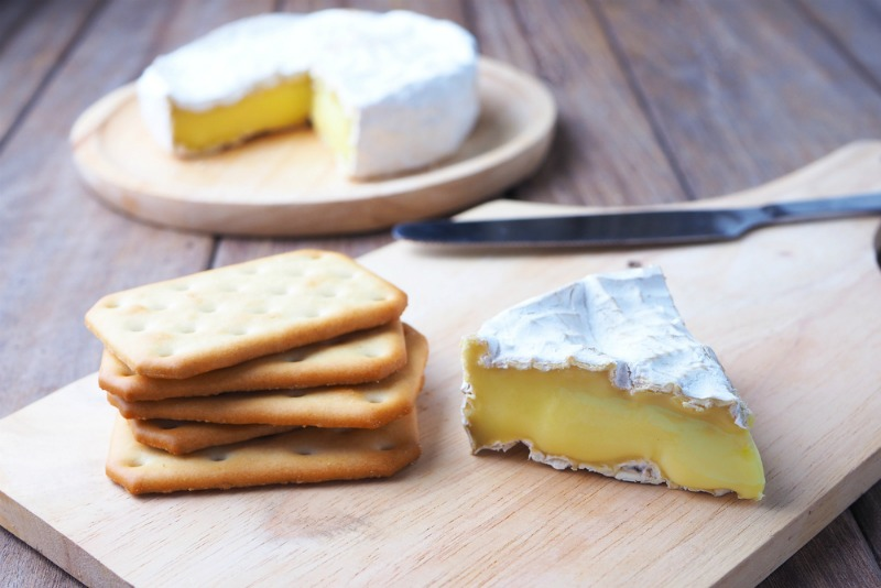 An image showing brie and crackers