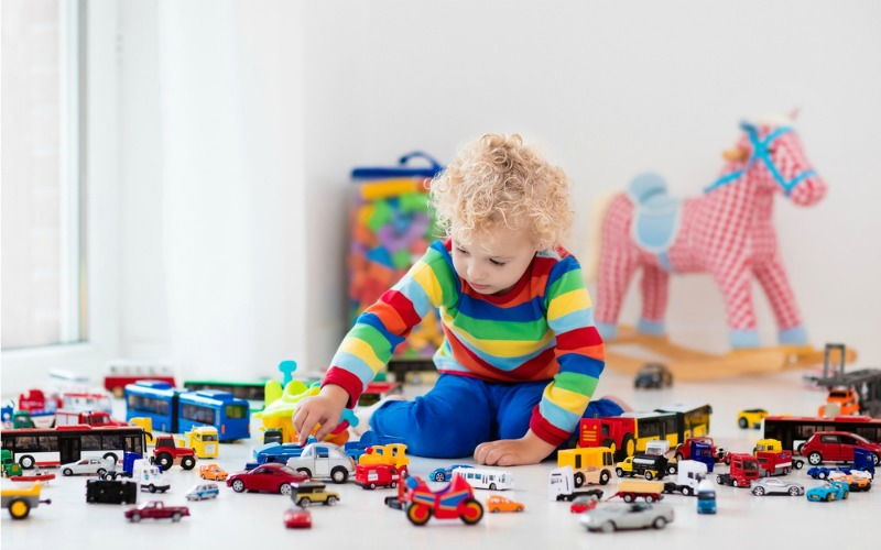 Child playing in messy bedroom