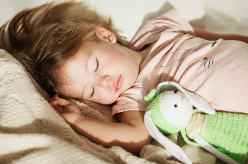 child sleeping with comfort toy