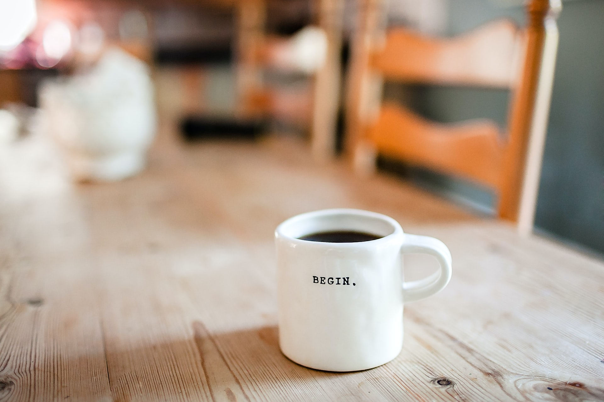 A mug with the word begin on the front