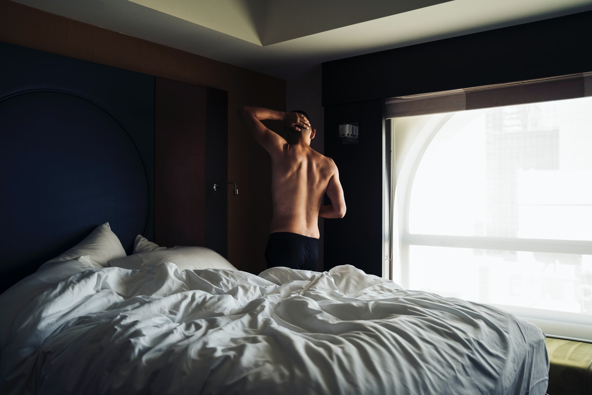 A man waking up from bed