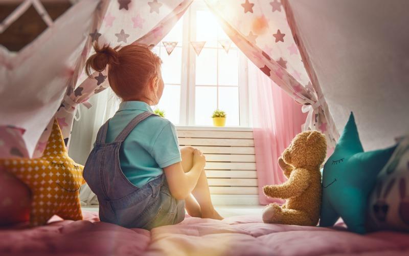 Girl in tepee in bedroom