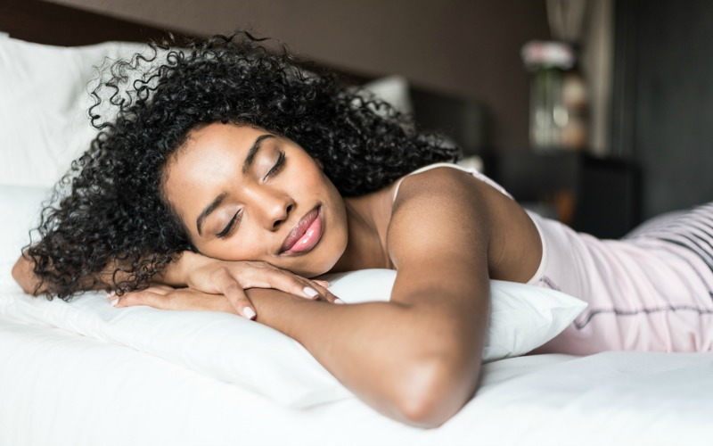 Happy woman sleeping