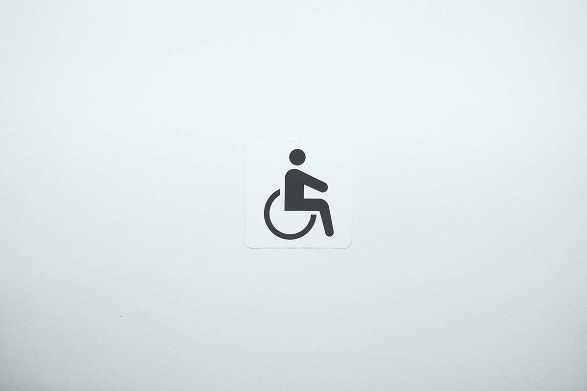 graphic of wheelchair user in the middle of a white square