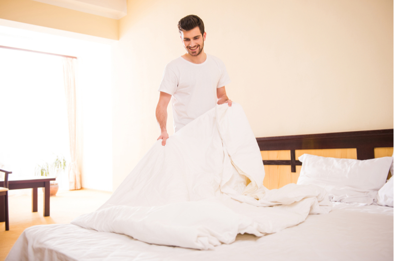 Man making bed