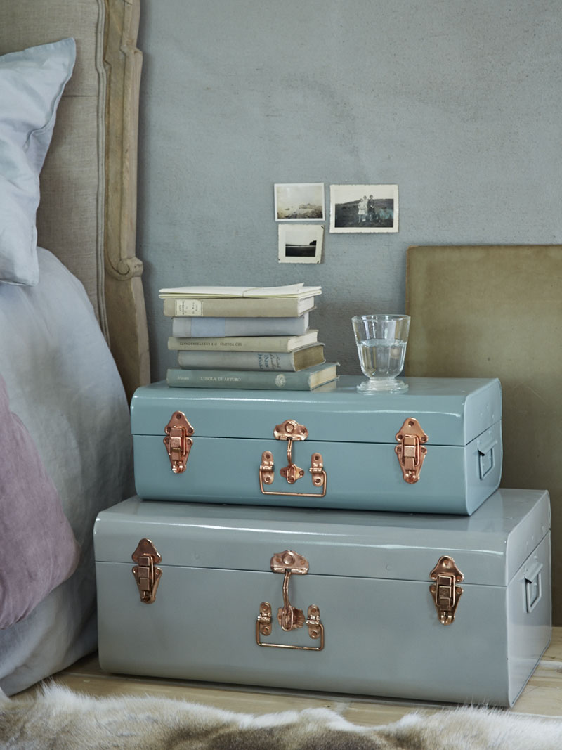 Image of pastel suitcases in relaxing retreat bedroom.