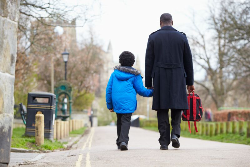 Parent and child walking to school