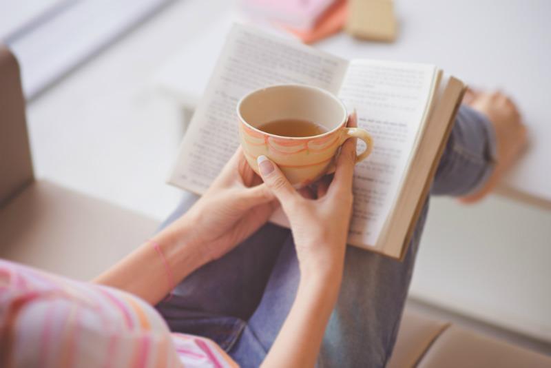 Woman reading to help oversleeping