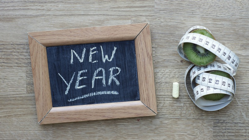 Image of a resolution list chalk board with tape measure and kiwi fruit