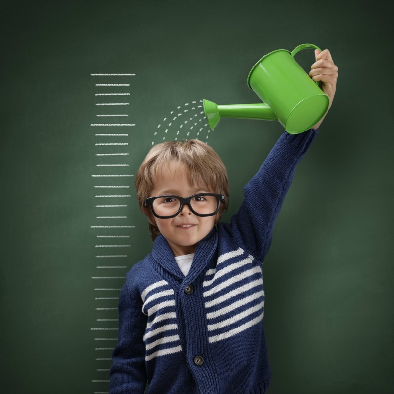 An image of child with a watering can