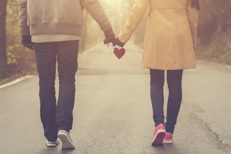 image of a romantic couple walking hand in hand