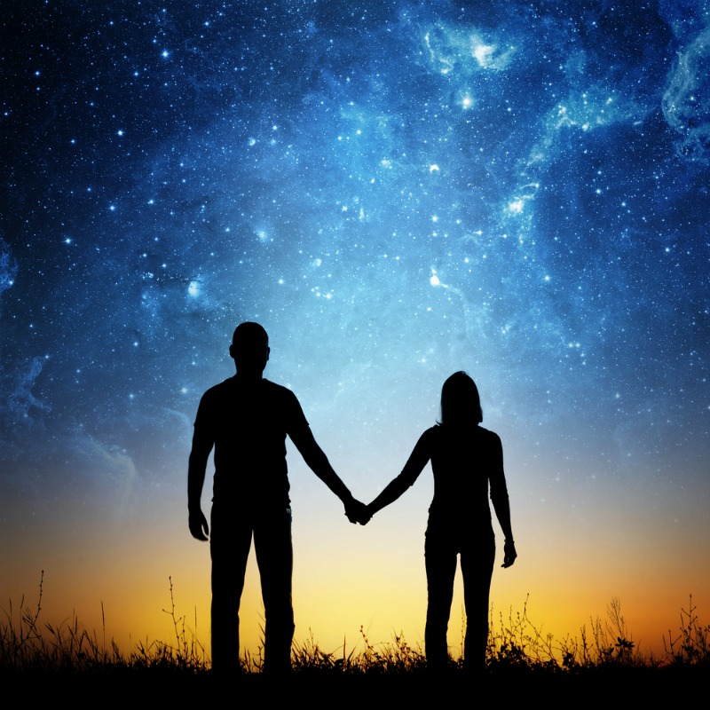 Image of a couple under sky in one of the many unique ways to have a date